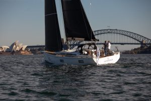 swan 48 sailing harbour bridge on background